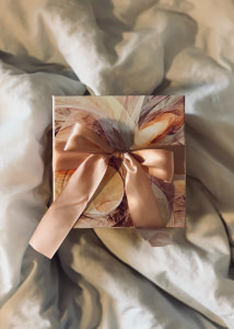 white and brown floral paper on white textile