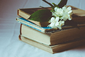 white flowers on books