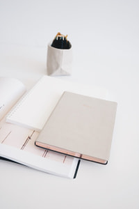 three assorted-color notebooks