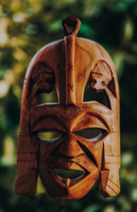 tilt shift lens photography of brown wooden mask