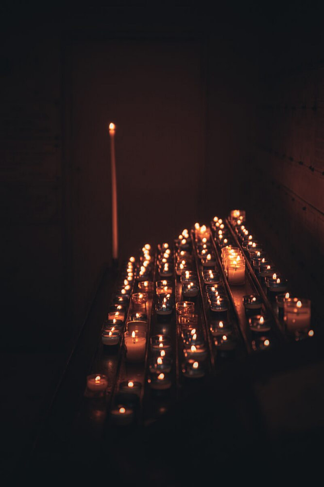lighted candles on the dark
