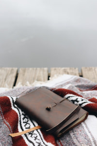brown leather wallet on red and white textile