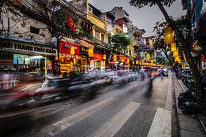 time lapse photography of vehicle towards pedestrian lane
