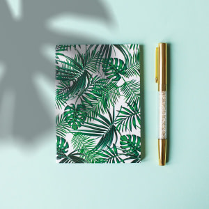 green floral covered notebook