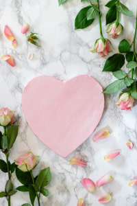 pink heart shaped paper on white and pink floral textile